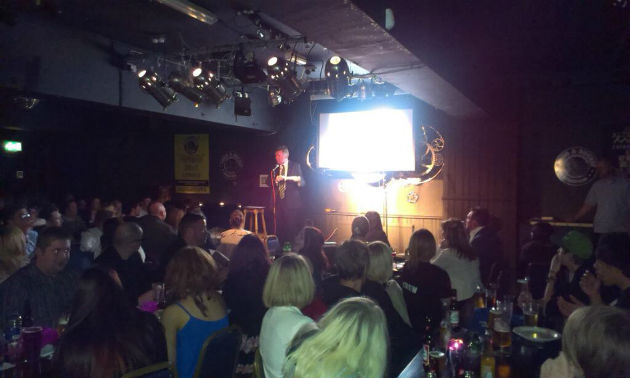 John Gillmore on stage presenting the awards