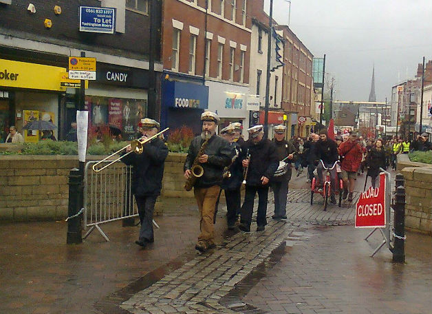 A brass band leads the parade up Fishergate to the Flag Market