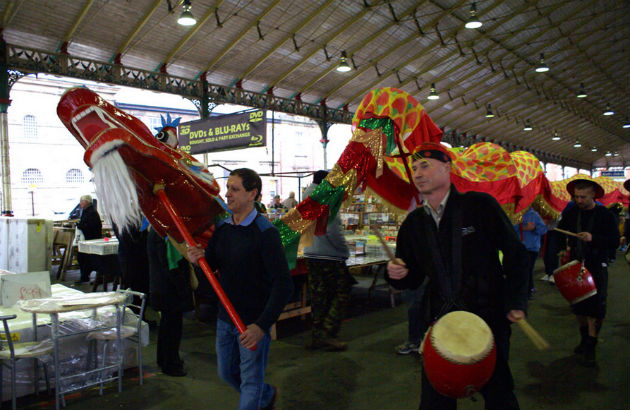The dragon makes its way through the covered market