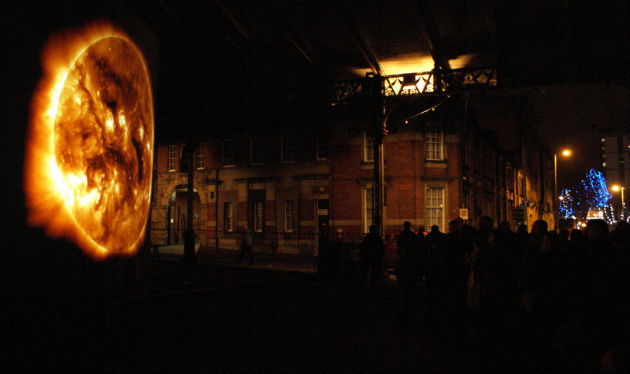 The Sun at Night projected on the market in Preston