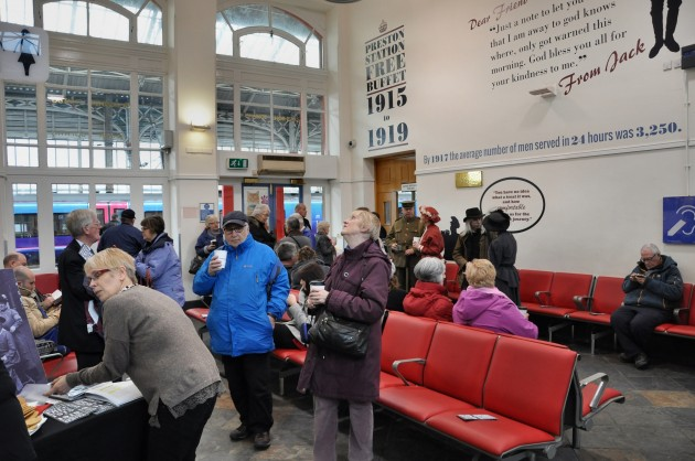 Visitors inspecting the waiting room and enjoying free refreshments
