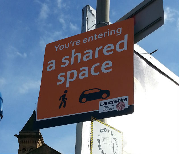 "New road signs say motorists are entering a ""shared space"""