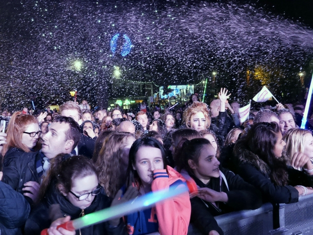 In true Christmas spirit, snow showers down on the crowds at switch-on