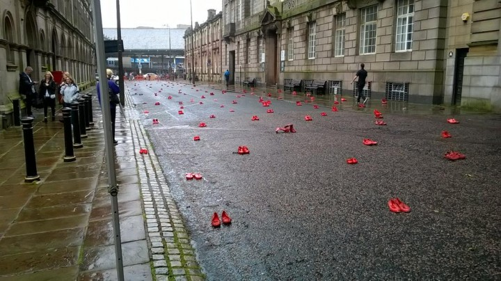 Passers-by stopped to snap pictures of the red shoes Pic: Birley Gallery