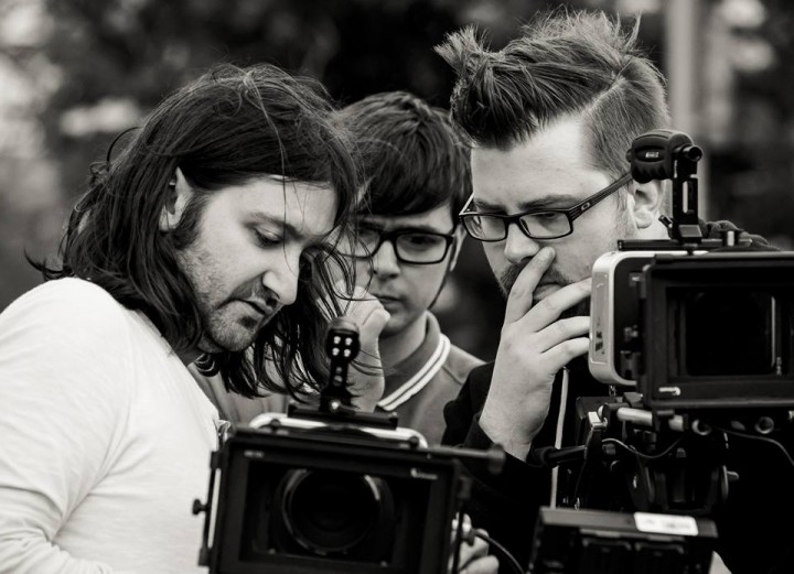 Cameramen, John Corrin (left) and Phil McMillan (right), check-out some footage of the film with coordinating director, Alan Livesey