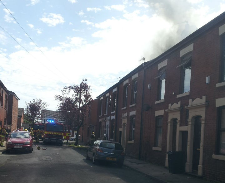 Smoke can be seen billowing from the roof of the house, understood to be a student property Pic: Murray Walker