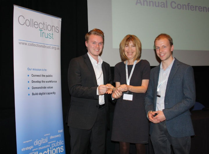 Matthew Ball, Money Matters Project Curator (left) and James Arnold, Curator of Social History (right) receiving the Collections Practice award from Alex Dawson, Programmes Manager (Standards), Collections Trust.