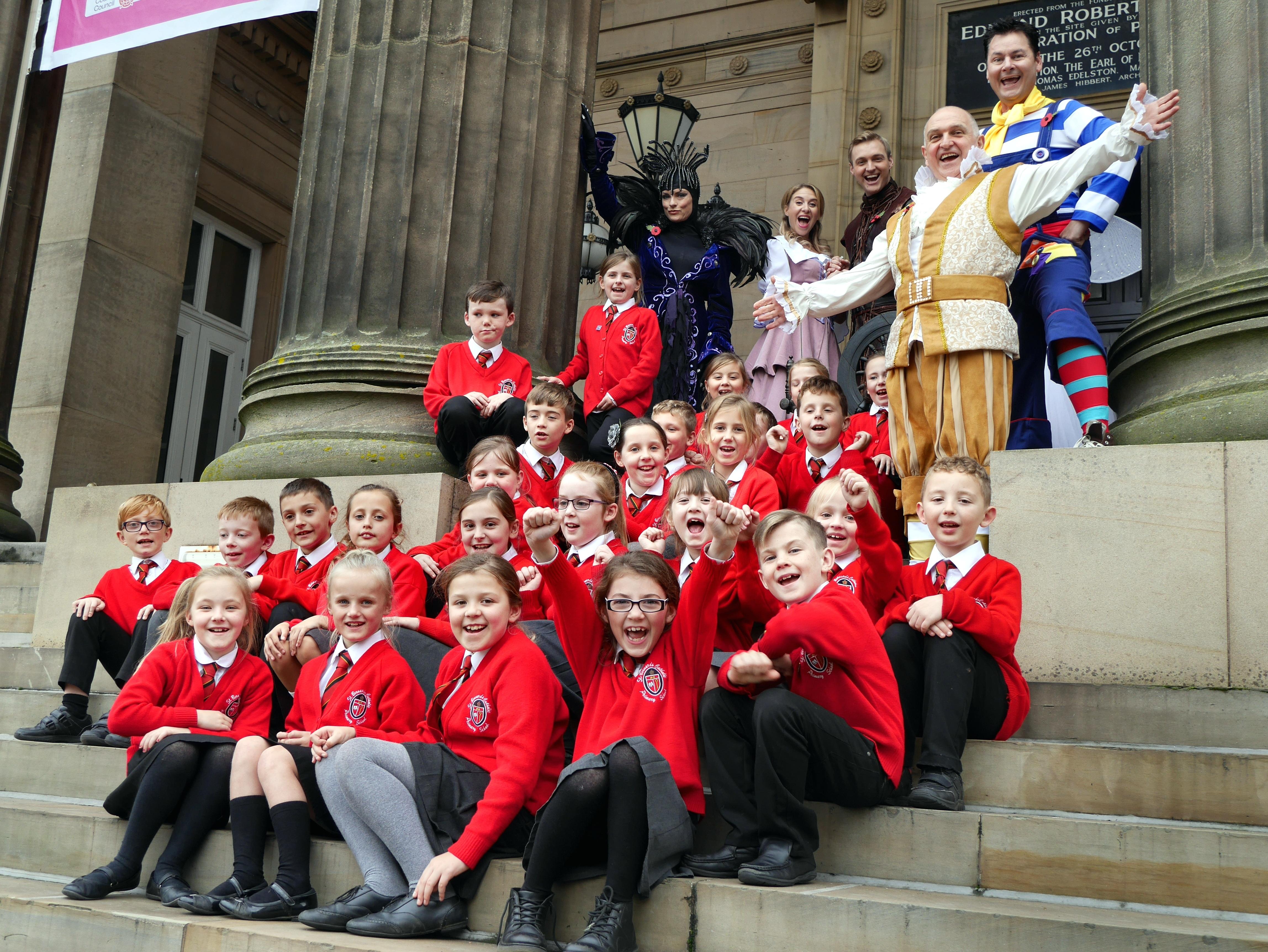 Pupils of St. Bernard's Catholic Primary School, Lea, Preston on the Harris balcony steps with the cast of Sleeping Beauty