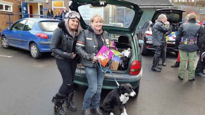 Laura, left, with a car full of supplies