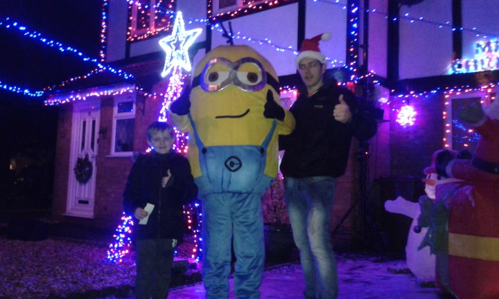 Mike the Minion with Ben and son at the Christmas house