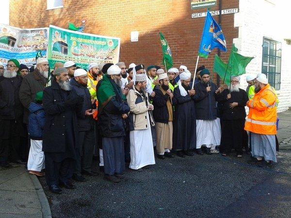 Arif, in the orange jacket, addressing Mosque elders