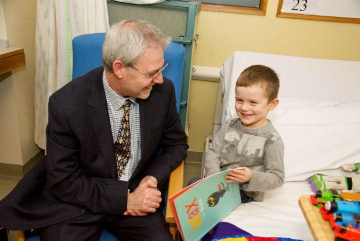 UCLan Vice-Chancellor Professor Mike Thomas discussing Max the Brave with three-year-old Jacob